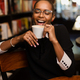 Black african american young yoman drinking coffee - PhotoDune Item for Sale