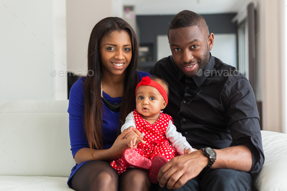 Portrait of a young african american  couple with her baby girl - Stock Photo - Images