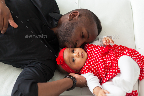 Young african american father holding with her baby girl - Stock Photo - Images