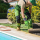 Professional Gardener Working Next to Outdoor Pool - PhotoDune Item for Sale