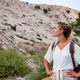 Hiker girl on trekking trail resting and looking at mountain, travel and active lifestyle concept - PhotoDune Item for Sale