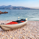 Empty kayak on beach over sea bay landscape, background with copyspace - PhotoDune Item for Sale