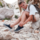 Hiker girl with ankle injury feels pain in leg - PhotoDune Item for Sale