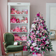 Interior room decorated in Christmas style. No people. An empty green chair. Pink colors. Home - PhotoDune Item for Sale