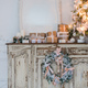Christmas tree on wooden chest of drawers commode bureau in white interior, decorated with - PhotoDune Item for Sale