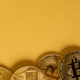 Gold Bitcoin Coins Lying On Golden Background - PhotoDune Item for Sale