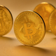 Closeup of gold bitcoin coins standing on yellow backgound - PhotoDune Item for Sale