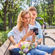 A couple using a compact SLR photo camera. - PhotoDune Item for Sale