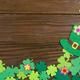 Happy Saint Patrick's mockup of handmade felt hat flowers and shamrock clover leaves - PhotoDune Item for Sale