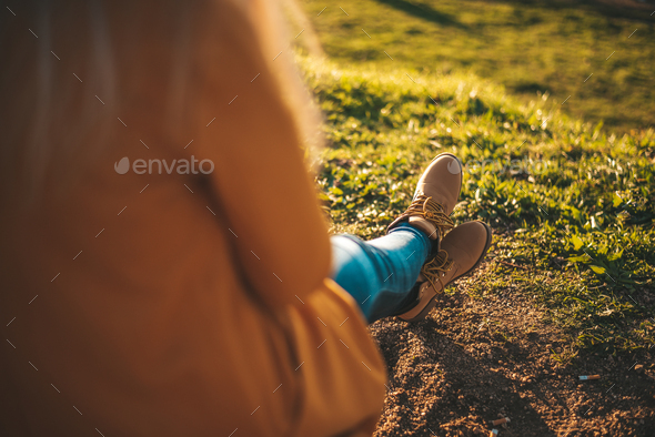 Woman relaxing at sunset - Stock Photo - Images