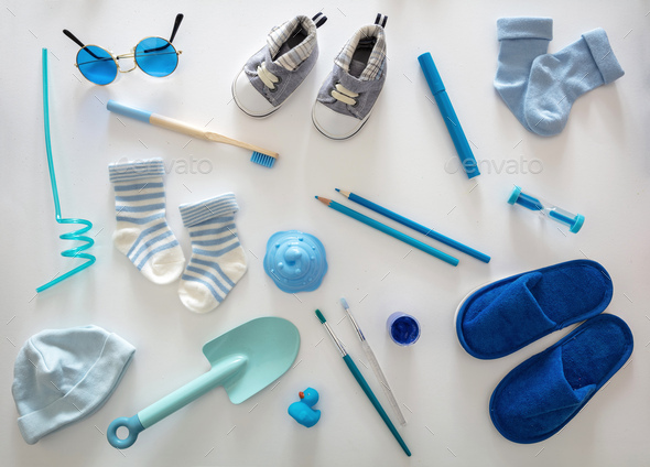 Baby boy blue color accessories on white background, top view. - Stock Photo - Images