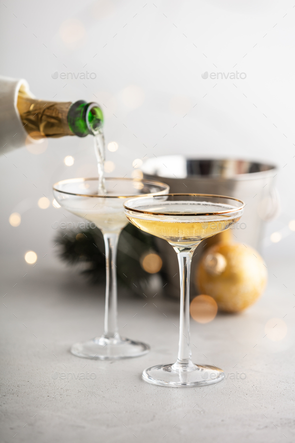 Champagne pouring into glasses and Christmas decorations - Stock Photo - Images