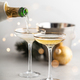 Champagne pouring into glasses and Christmas decorations - PhotoDune Item for Sale