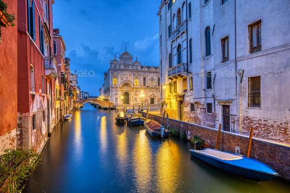 Canal in the old town of Venice at dusk - Stock Photo - Images