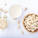 Vegan Cashew nut milk on white background. Non dairy alternative vegan milk - PhotoDune Item for Sale