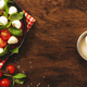 Caprese - italian salad with red tomatoes and mozzarella cheese with green basil leaves - PhotoDune Item for Sale