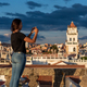 Woman taking pictures of the views over Sucre, Bolivia - PhotoDune Item for Sale
