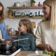 Happy three generations women cooking in the kitchen - PhotoDune Item for Sale