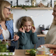 Portrait of little girl playing with cucumber in the kitchen - PhotoDune Item for Sale