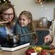Three women in kitchen preparing Christmas food - PhotoDune Item for Sale