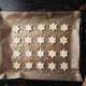 Top view of baking tray with raw star shaped cookies - PhotoDune Item for Sale