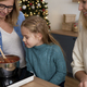 Little girl in the kitchen with her mother and grandma - PhotoDune Item for Sale