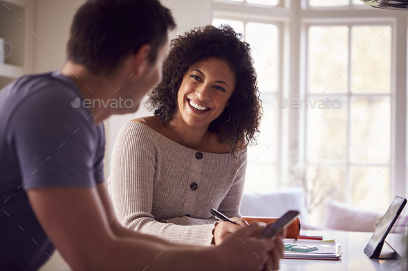 Couple With Digital Tablet Working From Home On Kitchen Counter - Stock Photo - Images