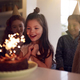 Girl Celebrating Birthday With Group Of Friends At Home Being Given Cake Decorated With Sparkler - PhotoDune Item for Sale