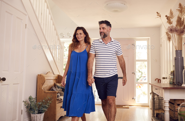 Couple Looking Around New Home Before They Move In - Stock Photo - Images