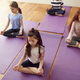 Group Of Children Sitting On Exercise Mats And Meditating In Yoga Studio - PhotoDune Item for Sale