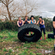 Female participants in an obstacle course turning a wheel - PhotoDune Item for Sale