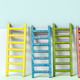 Multicoloured ladders on wall. Pastel tones. Concept for success and growth. - PhotoDune Item for Sale