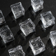 Ice cubes on black stone board. Hard light. Deep shadows. Cold and freshness concept. - PhotoDune Item for Sale
