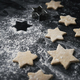 Close up of raw Christmas cookies on black background - PhotoDune Item for Sale