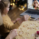 Little girl showing her grandma Christmas cookies during video conference - PhotoDune Item for Sale