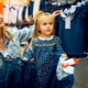 Mother and little baby choosing dress, kid's store - PhotoDune Item for Sale
