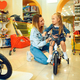 Mom and little girl buying bicycle in kid's store - PhotoDune Item for Sale
