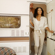 Happy woman poses at rv entrance,camp in trailer - PhotoDune Item for Sale