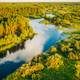 Aerial Elevated View Of Green Forest Growth On River Coast Landscape In Sunny Summer Evening - PhotoDune Item for Sale
