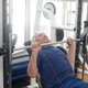 Elderly male is having intense workout in gym - PhotoDune Item for Sale