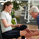 Fit young woman having knee pain at gym - PhotoDune Item for Sale
