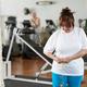 Mature caucasian woman measuring waist in gym - PhotoDune Item for Sale