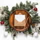 Envelope with blank card on wooden plate and christmas tree branches - PhotoDune Item for Sale