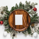 Envelope with blank card on wooden plate and christmas tree branches. - PhotoDune Item for Sale