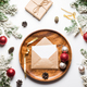 Christmas and new year invitation in envelope on wooden dish with christmas decoration - PhotoDune Item for Sale