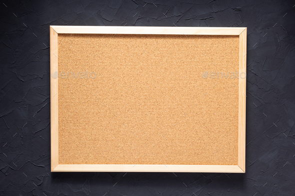 cork board at dark concrete painted wall - Stock Photo - Images