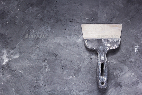 putty knife at painted surface background - Stock Photo - Images