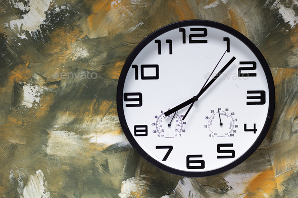 wall clock at colorful paintes texture - Stock Photo - Images