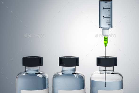 A syringe and three bottles of medicine - Stock Photo - Images