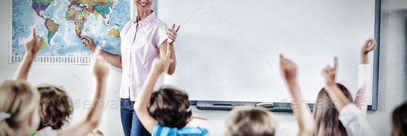 Teacher teaching kids in classroom - Stock Photo - Images